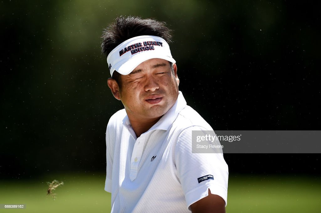Yuta Ikeda of Japan reacts to a gust of wind on the 11th hole during Round One of the DEAN & DELUCA Invitational at Colonial Country Club on May 25, 2017 in Fort Worth, Texas.