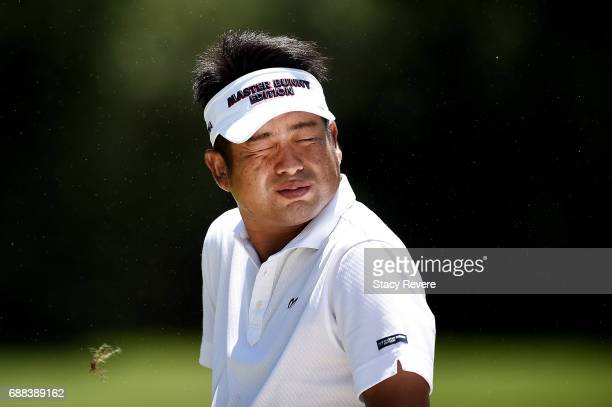 Yuta Ikeda of Japan reacts to a gust of wind on the 11th hole during Round One of the DEAN DELUCA Invitational at Colonial Country Club on May 25...