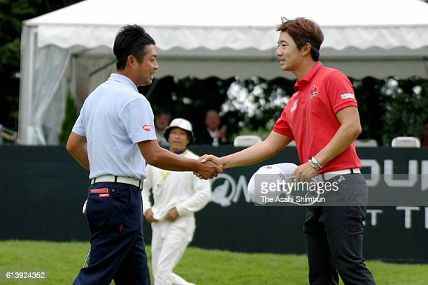 Yuta Ikeda of Japan shakes hands with Song YoungHan of South Korea after winning through the playoff in the Homna Tourworld Cup At Trophia Golf at...
