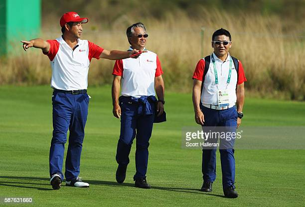 Yuta Ikeda of Japan walks with Massy Kuramoto and Shigeki Maruyama during a practice round on Day 4 of the Rio 2016 Olympic Games at Olympic Golf...