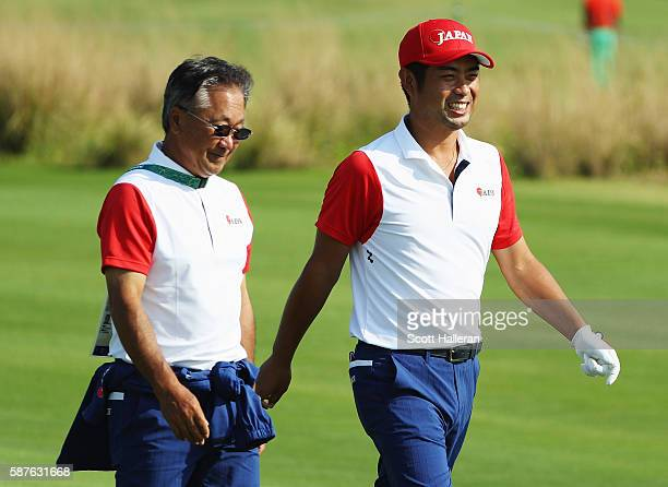 Yuta Ikeda of Japan walks with Massy Kuramoto during a practice round on Day 4 of the Rio 2016 Olympic Games at Olympic Golf Course on August 9 2016...