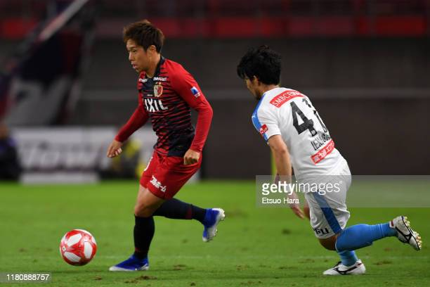Yuta Koike of Kashima Antlers and Akihiro Ienaga of Kawasaki Frontale compete for the ball during the J.League Levain Cup semi final second leg match...