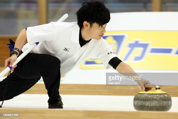 Yuta Matsumura of Sapporo throws a stone during Game Two of the Curling Japan Qualifying Tournament between SC Karuizawa and Sapporo at Dohgin...