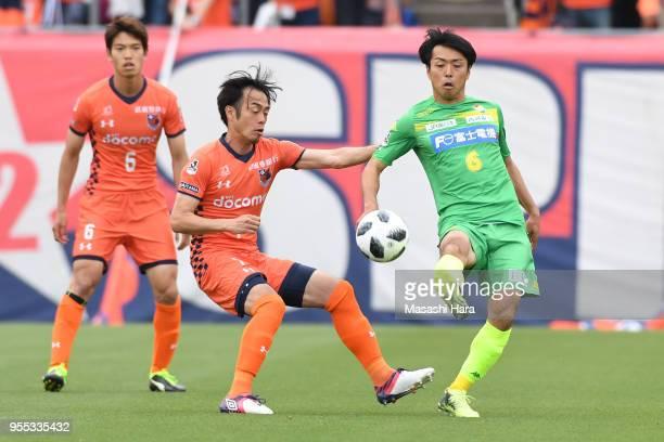 Yuta Mikado of Omiya Ardija and Masaki Yamamoto of JEF United Chiba compete for the ball during the JLeague J2 match between Omiya Ardija and JEF...