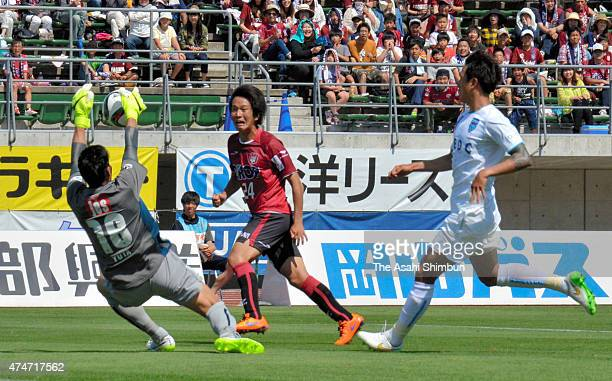 Yuta Minami of Yokohama FC makes a save a shot by Shinya Yajima of Fagiano Okayama during the J.League second division match between Fagiano Okayama...