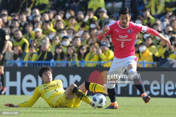 Yuta Nakayama of Kashiwa Reysol and Hotaru Yamaguchi of Cerezo Osaka compete for the ball during the JLeague J1 match between Kashiwa Reysol and...