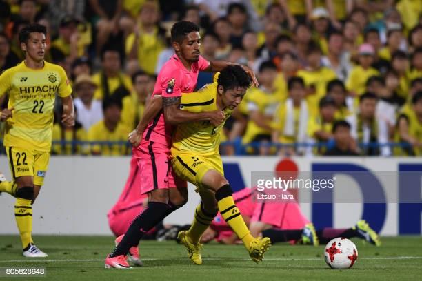 Yuta Nakayama of Kashiwa Reysol and Pedro Junior of Kashima Antlers compete for the ball during the JLeague J1 match between Kashiwa Reysol and...
