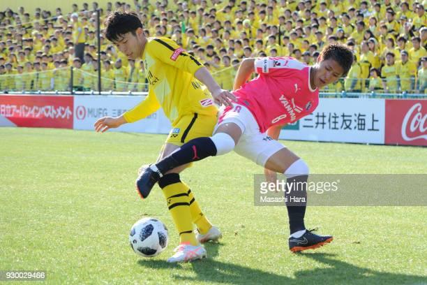 Yuta Nakayama of Kashiwa Reysol and Yoichiro Kakitani of Cerezo Osaka compete for the ball during the JLeague J1 match between Kashiwa Reysol and...