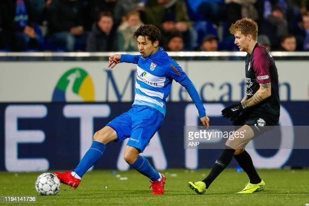 Yuta Nakayama of PEC Zwolle, Simon Gustafson of FC Utrecht during the Dutch Eredivisie match between PEC Zwolle and FC Utrecht at the MAC3Park...