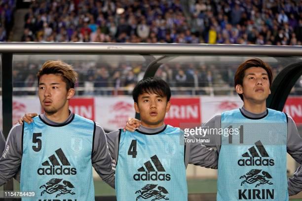 Yuta Nakayama Takefusa Kubo and Yuya Osako of Japan stand for the national anthems prior to the international friendly match between Japan and El...