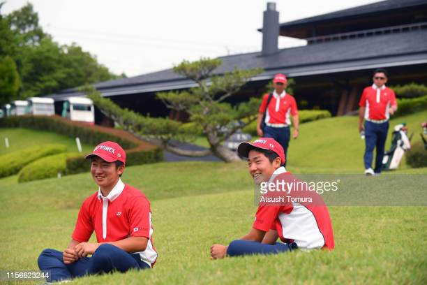 Yuta Sugiura and Takara Oshima of Japan watch their teammates playing during the first round of the Toyota Junior Golf World Cup at Chukyo Golf Club...