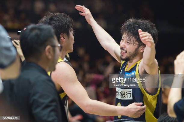 Yuta Tabuse and Hironori Watanabe of Tochigi Brex celebrate after defeating the Kawasaki Brave Thunders 8579 to win the B League final match at...