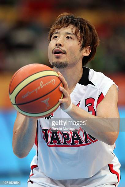 Yuta Tabuse of Japan at the free throw line in the second half against Iran during the men's bronze medal basketball game at the Guangzhou...