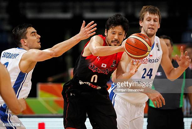 Yuta Tabuse of Japan in action against Tomas Satoransky and Jan Vesely of Czech Republic during the 2016 FIBA World Olympic Qualifying basketball...
