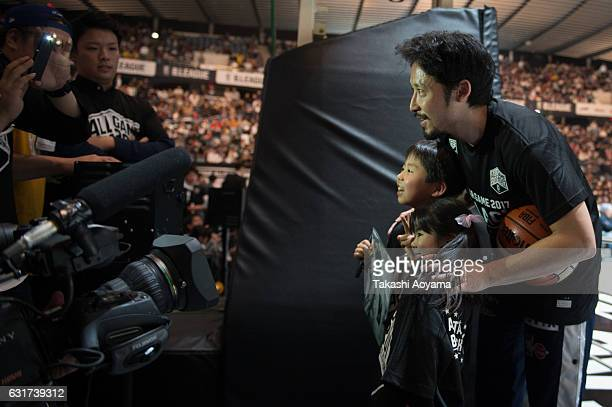 Yuta Tabuse of the BBlack poses for a photograph with fans prior to the B league Allstar Game match between B Black and B White as part of the 2017...