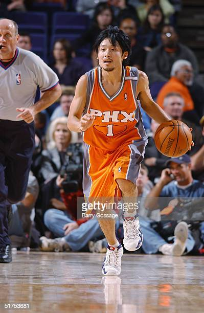 Yuta Tabuse of the Phoenix Suns dribbles the ball against the Atlanta Hawks during the game at America West Arena on November 3 2004 in Phoenix...