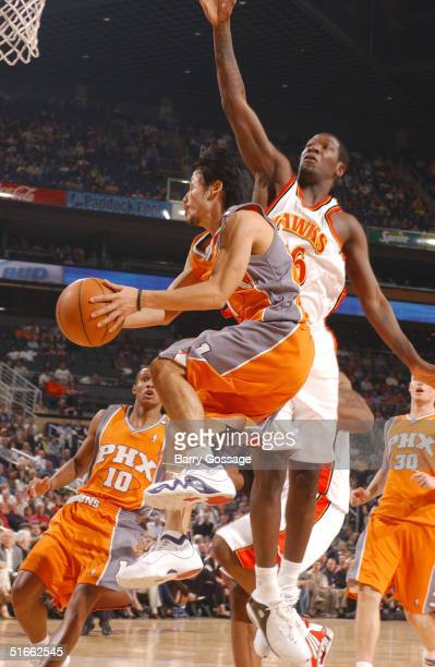 Yuta Tabuse of the Phoenix Suns drives against Royal Ivey of the Atlanta Hawks on November 3 2004 at America West Arena in Phoenix Arizona NOTE TO...