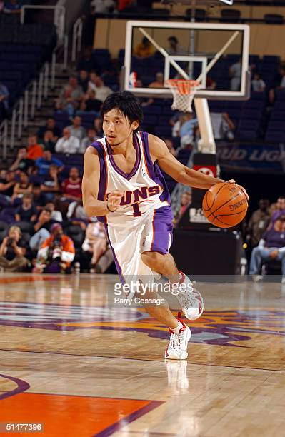 Yuta Tabuse of the Phoenix Suns drives against the Los Angeles Clippers on October 13 2004 at America West Arena in Phoenix Arizona NOTE TO USER User...