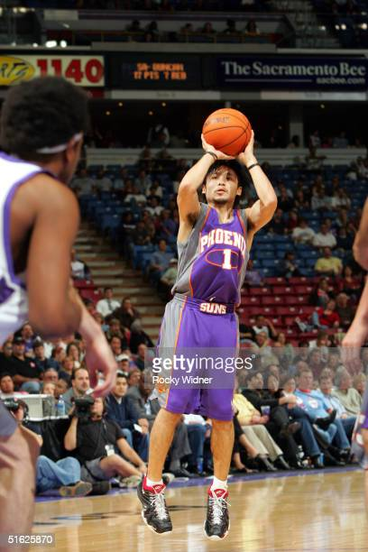 Yuta Tabuse of the Phoenix Suns shoots the ball against the Sacramento Kings during the game on October 29 at Arco Arena in Sacramento California...