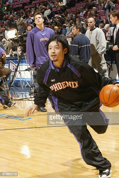 Yuta Tabuse of the Phoenix Suns warms up before their game against the New Jersey Nets on November 6 2004 at Continental Airlines Arena in East...