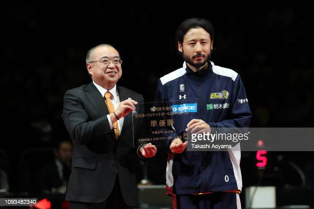Yuta Tabuse of Tochigi Brex receives the 2nd place plate during awards ceremony following the the Basketball 94th Emperor's Cup Final between Tochigi...