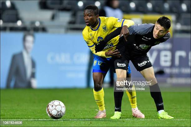 Yuta Toyokawa and Samuel Asamoah fight for the ball during the Jupiler Pro League match between KAS Eupen and SintTruidense VV at Kehrwegstadion on...