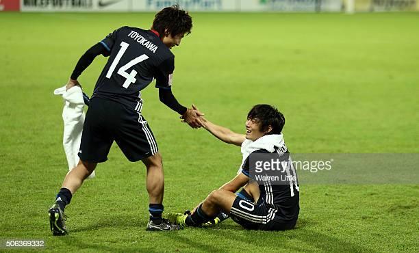 Yuta Toyokawa and Shoya Nakajima of Japan shake hands after the AFC U23 Championship quarter final match between Japan and Iran at the Abdullah Bin...