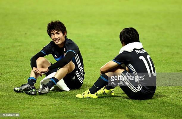 Yuta Toyokawa and Shoya Nakajima of Japan sit together after the AFC U23 Championship quarter final match between Japan and Iran at the Abdullah Bin...