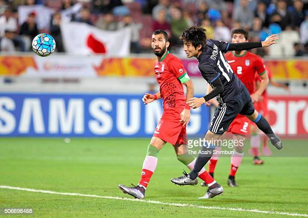 Yuta Toyokawa of Japan heads the ball to score his team's frist goal in the extra time during the AFC U23 Championship quarter final match between...