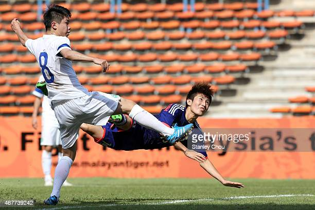 Yuta Toyokawa of Japan heads to score his team's second goal against Macau during the AFC U23 Championship Qualifier Group I match between Japan and...