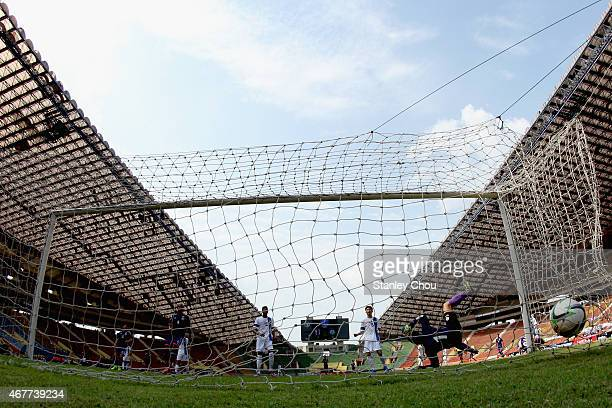 Yuta Toyokawa of Japan scores his team's second goal against Macau during the AFC U23 Championship Qualifier Group I match between Japan and Macau at...