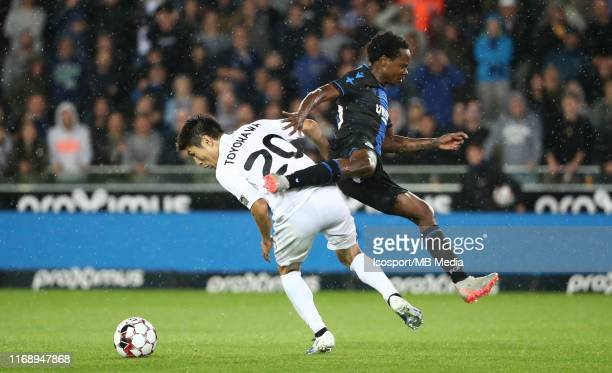 Yuta Toyokawa of Kas Eupen battles for the ball with Percy Tau of Club Brugge during the Jupiler Pro League match between Club Brugge KV and AS Eupen...