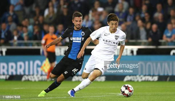 Yuta Toyokawa of Kas Eupen battles for the ball with Siebe Schrijvers of Club Brugge during the Jupiler Pro League match between Club Brugge KV and...
