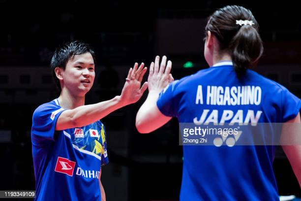 Yuta Watanabe and Arisa Higashino of Japan celebrate during the match against Zheng Si Wei and Huang Ya Qiong of China on day 1 of the HSBC BWF World...