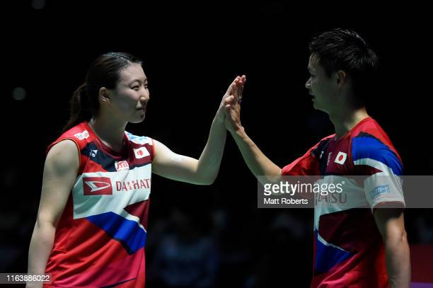 Yuta Watanabe and Arisa Higashino of Japan celebrate in the mixed doubles match against Seo Seung Jae and Chae Yujung of South Korea on day two of...