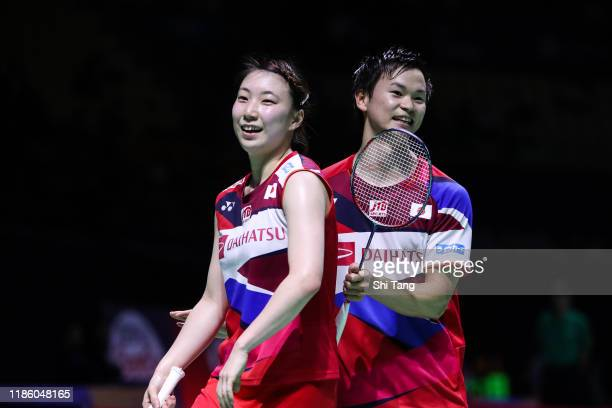 Yuta Watanabe and Arisa Higashino of Japan celebrate the victory in the Mixed Doubles second round match against Ren Xiangyu and Zhou Chaomin of...