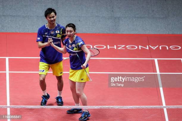 Yuta Watanabe and Arisa Higashino of Japan celebrate the victory in the Mixed Doubles round robin match against Zheng Siwei and Huang Yaqiong of...