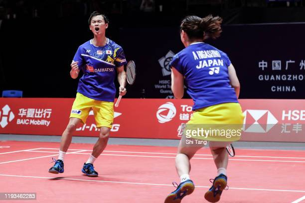 Yuta Watanabe and Arisa Higashino of Japan celebrate the victory in the Mixed Doubles round robin match against Melati Daeva Oktavianti and Praveen...