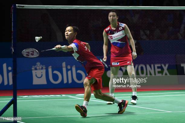 Yuta Watanabe and Arisa Higashino of Japan compete against Chris Adcock and Gabrielle Adcock of England on day one of the Bli Bli Indonesia Open at...