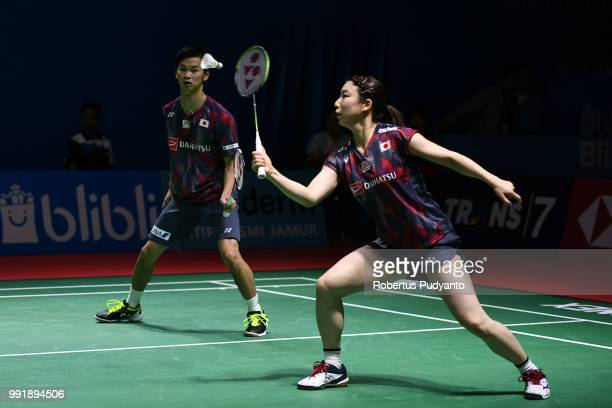 Yuta Watanabe and Arisa Higashino of Japan compete against Chris Adcock and Gabrielle Adcock of England during the Mixed Doubles Round 2 match on day...