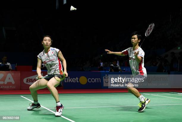 Yuta Watanabe and Arisa Higashino of Japan compete against Zheng Siwei and Huang Yaqiong of China during the Mixed Doubles Quarterfinal match on day...