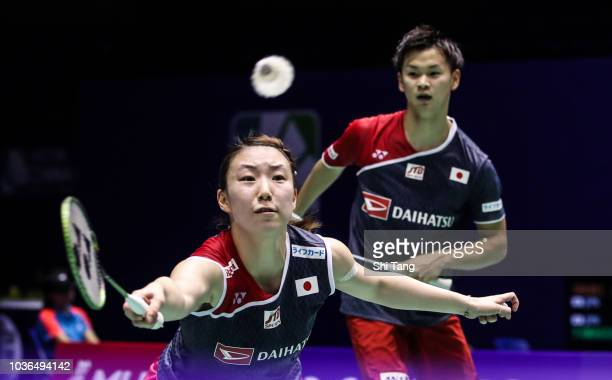 Yuta Watanabe and Arisa Higashino of Japan compete in the Mixed Doubles second round match against Tontowi Ahmad and Liliyana Natsir of Indonesia on...