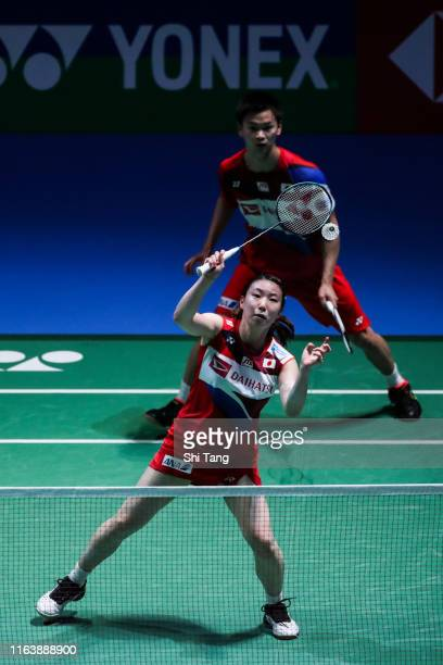 Yuta Watanabe and Arisa Higashino of Japan compete in the Mixed Doubles first round match against Seo Seung Jae and Chae Yujung of Korea during day...