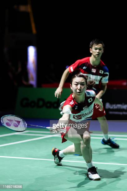 Yuta Watanabe and Arisa Higashino of Japan compete in the Mixed Doubles second round match against Rinov Rivaldy and Pitha Haningtyas Mentari of...
