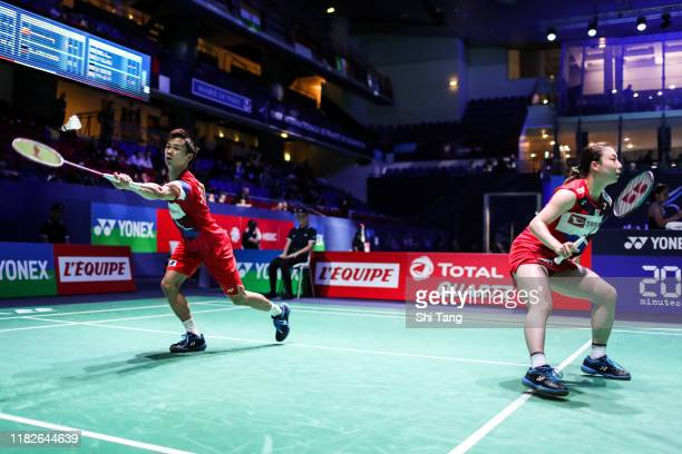 Yuta Watanabe and Arisa Higashino of Japan compete in the Mixed Doubles first round match against Rodion Alimov and Alina Davletova of Russia on day...