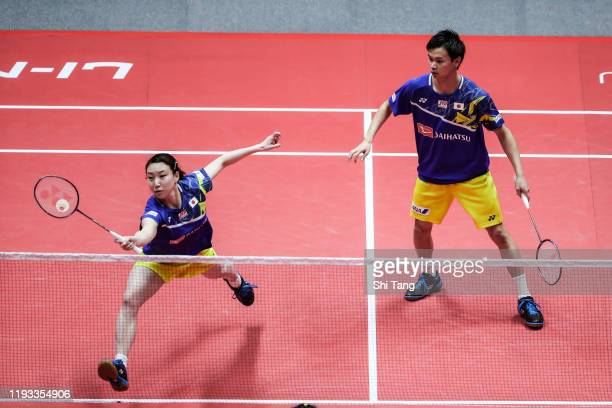 Yuta Watanabe and Arisa Higashino of Japan compete in the Mixed Doubles round robin match against Zheng Siwei and Huang Yaqiong of China during day...