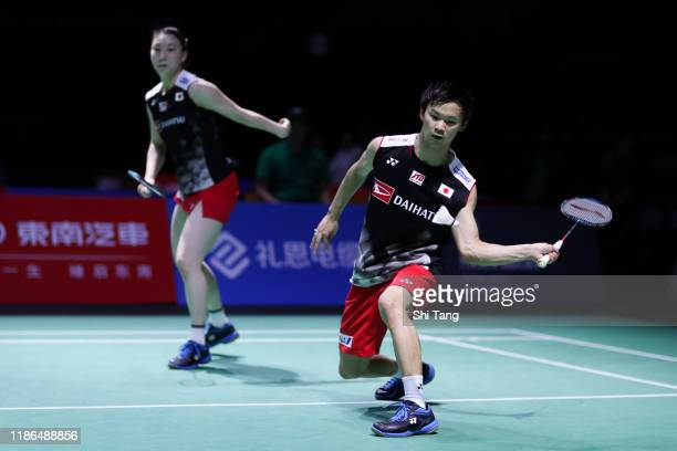 Yuta Watanabe and Arisa Higashino of Japan compete in the Mixed Doubles semi finals match against Wang YiLyu and Huang Dongping of China on day five...