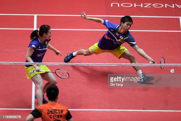 Yuta Watanabe and Arisa Higashino of Japan compete in the Mixed Doubles semi finals match against Zheng Siwei and Huang Yaqiong of China during day...