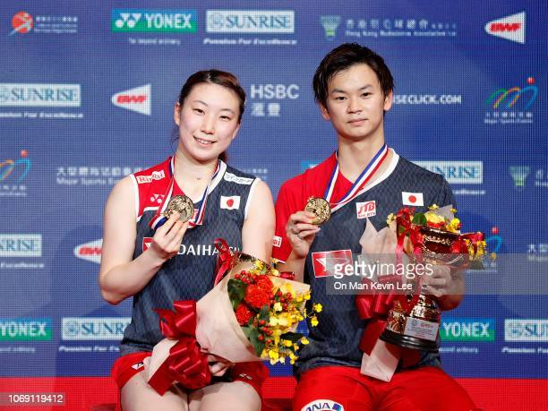 Yuta Watanabe and Arisa Higashino of Japan poses with their trophies after the final of Mixed Double of Yonex Sunrise Hong Kong Open 2018 on Day 6 at...