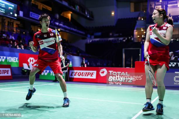 Yuta Watanabe and Arisa Higashino of Japan react in the Mixed Doubles first round match against Rodion Alimov and Alina Davletova of Russia on day...